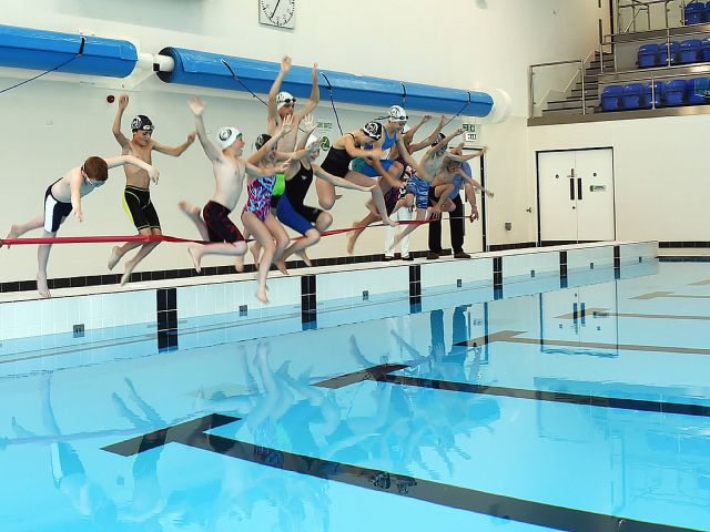 Swimmers from Workington ASA help to officially open the new Workington Leisure Centre. pic MIKE McKENZIE 17th Sept 2016 Mark Fryer, left Babara Cannon and Alan Smith from Allerdale council hold the ribbon as members of Workington ASA jump in to take the first swim in the new Workington Leisure Centre during the official opening ceremony. pic Mike McKenzie